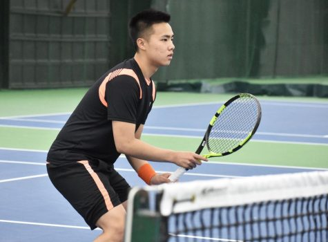 Both tennis teams hold winning records this season.