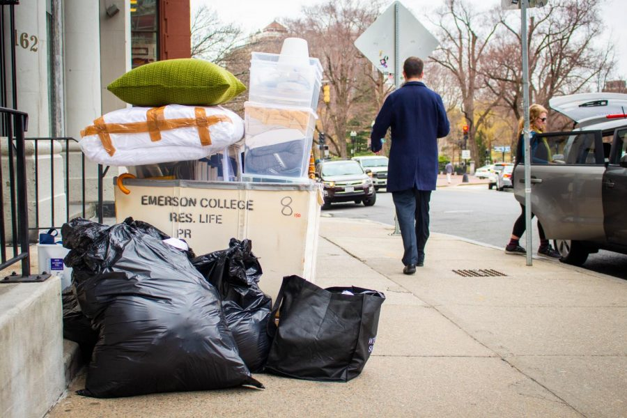 A pile of belonging rests curbside as one of the hundreds of Emerson students who live on campus squeezed everything they owned into their car.