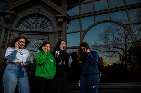 Freshman students left to right: Carrie Aubin, Chloe Shaar, Eva Charbonnnier, and Isabella Espejo, calling their parents to let them know of the college's decision asking them to leave campus by March 20, 2020.