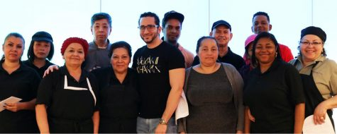 Daniel Suazo (front center), and most of his fellow dining center workers, are not receiving pay or benefits after their hours were eliminated in March.