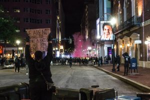 Protesters face off with police in the area of Tremont St. and Stuart St.