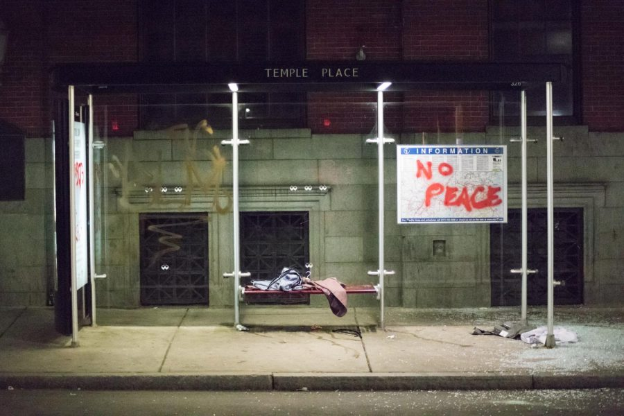 The Temple Place bus stop sat quietly after the protesters were pushed onto Tremont Street.