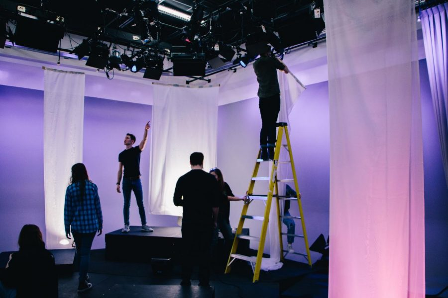 National Broadcast Society members work on a set.