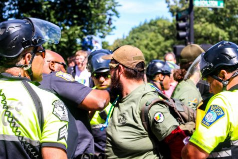 A protestor is arrested during last August's Straight Pride Parade. The group that organized the parade, Super Happy Fun America, is set to clash with counter-protestors Saturday afternoon at a pro-police rally.