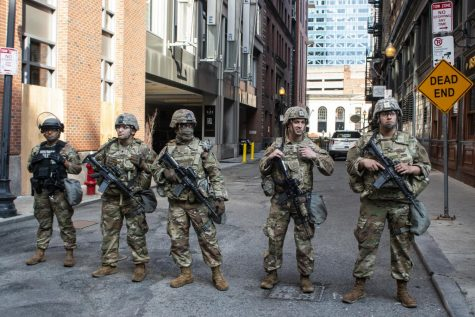 Four members of the National Guard and one member of the Military Police stood guard at the edge of Wednesday's protests.