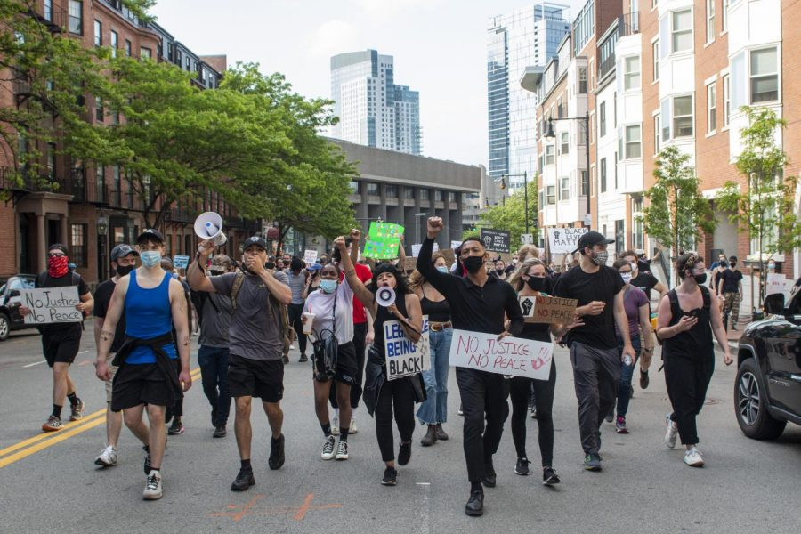 Black+Lives+Matter+protestors+chant+as+they+walked+up+Bowdoin+St.+approaching+the+State+House.