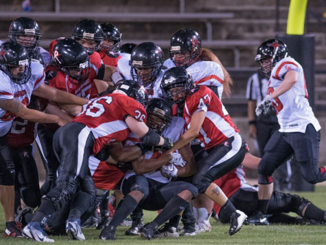 The Renegades team up for a tackle against a WFA opponent.