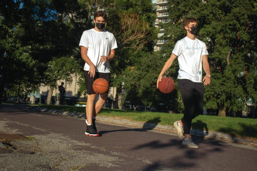 Men's basketball sophomores Stephen Fabrizio (left) and James Beckwith (right) are among the athletes who have found outdoor courts to sharpen their skills.