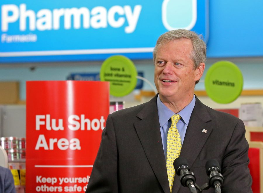Gov. Charlie Baker speaks to the media after receiving a flu shot at a CVS in Roslindale on September 17, 2020 in Boston, MA.