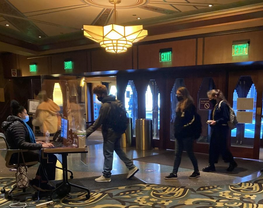 Students in the lobby of the Paramount Theatre tapping in to the building before class.