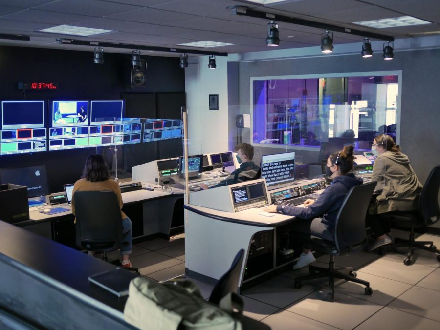 Students working in a control room for a visual and media arts course.