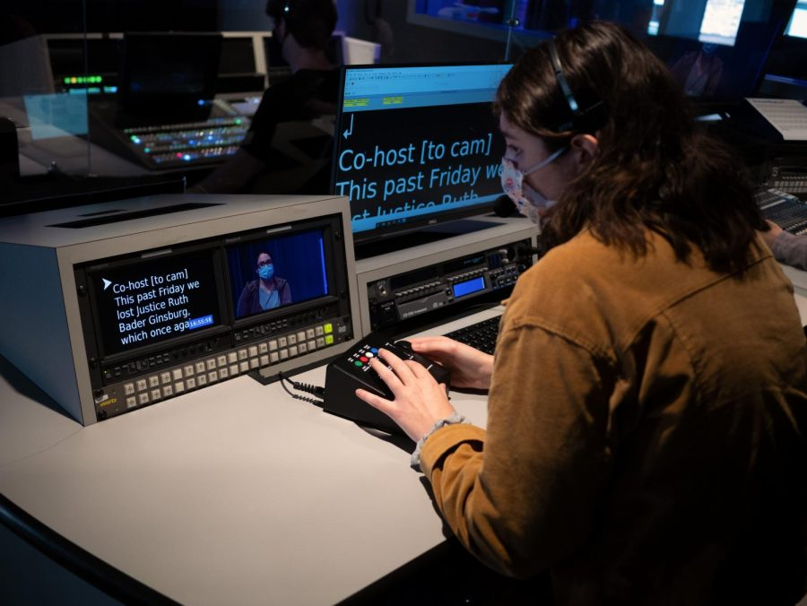 Students working in a control room for a visual and media arts course. Courtesy Wilson Chao
