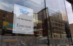 A sign on the window of Emerson's coronavirus testing site at Tufts Medical Center.