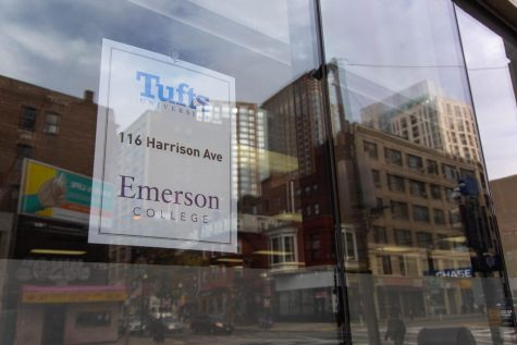 A sign on the window of Emersons coronavirus testing site at Tufts Medical Center.