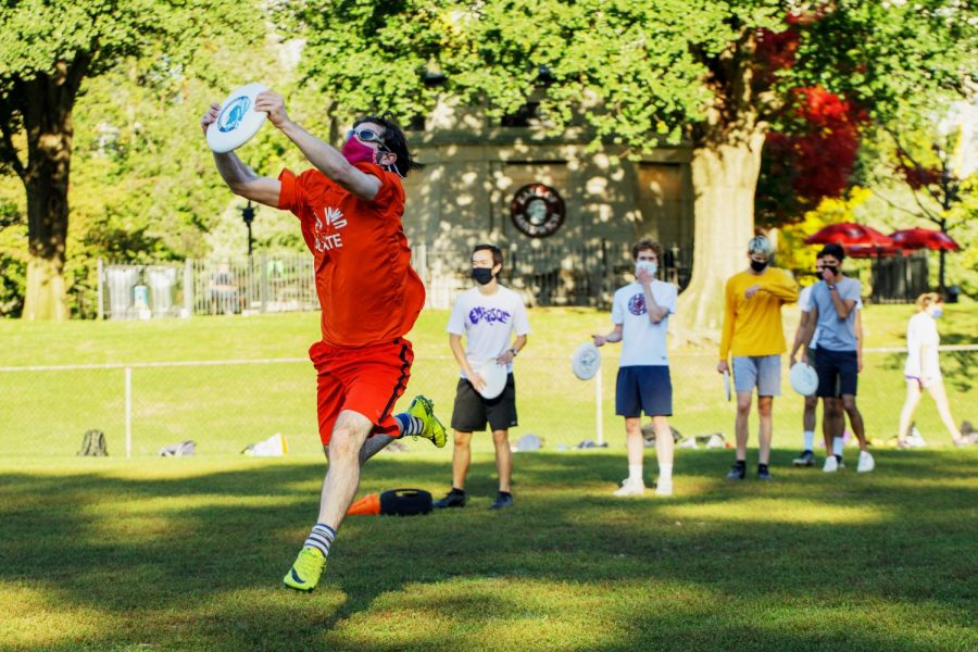 Robby Gessel catches a frisbee during ultimate frisbee practice for the Emerson Skunks.
