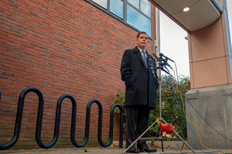 Marty Walsh speaks to reporters after casting a vote for Presidential Candidate Joe Biden at The Lower Mills branch of The Boston Public Library on November 3, 2020.