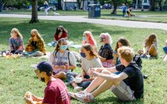 Student gather in Boston Common every Friday to watch others perform their stand-up comedy routines.
