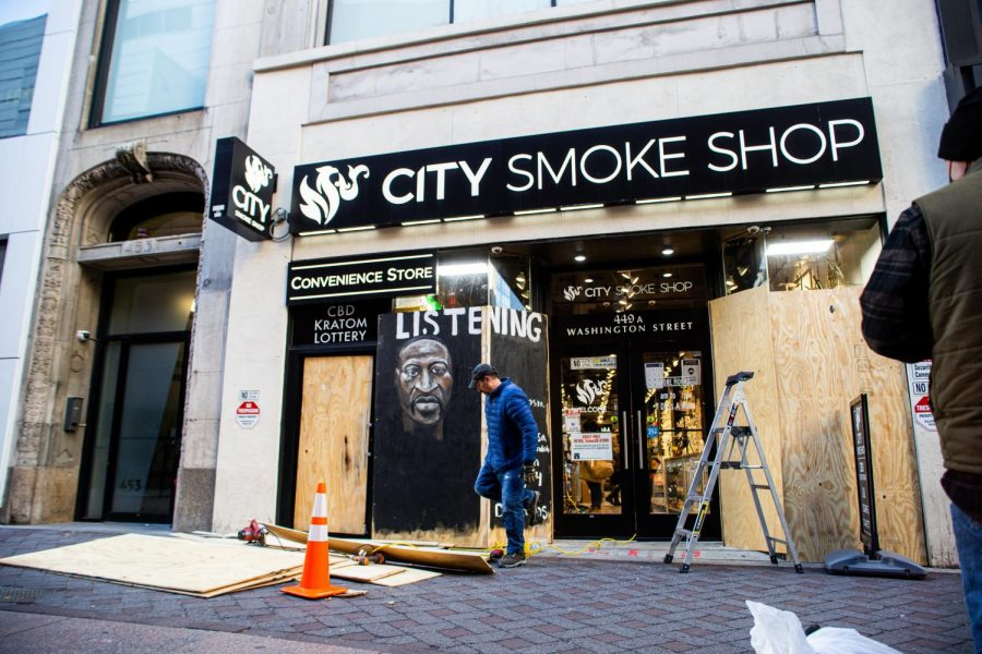 The outside of City Smoke Shop in Downtown Crossing is boarded up.