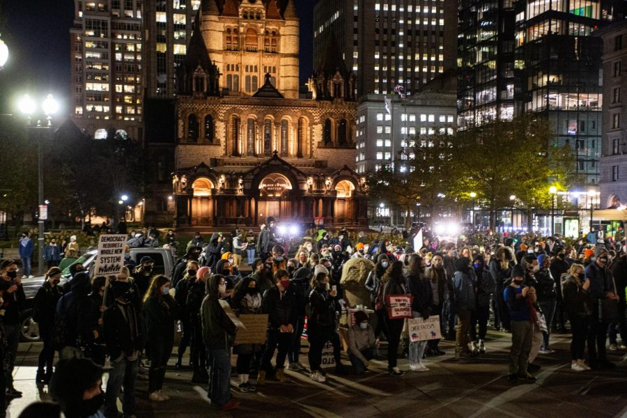 Hundreds of protestors listen to leaders outside the Boston Public Library Wednesday night in preparation for the presidential Election result.