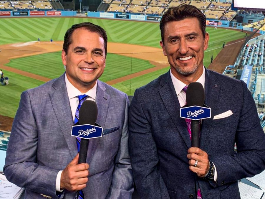 Tim Neverett '88 (left) alongside Dodgers co-commentator and ex-Red Sox shortstop Nomar Garciappara.