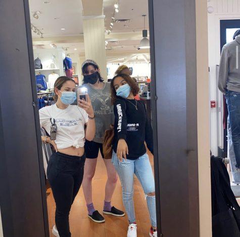 Junior Brianna Maloney, center, at her job at American Eagle in Cambridge.