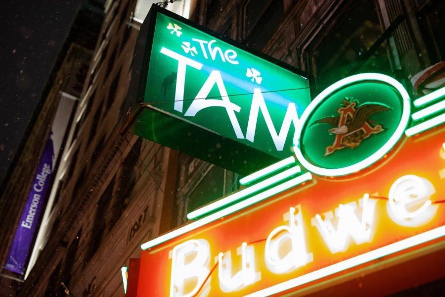 The glow of the green neon sign outside The Tam on Tremont Street.