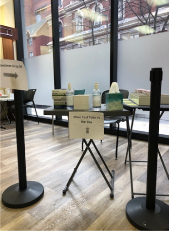 The tube drop-off table, where a Tufts staff member will sit to collect individuals
