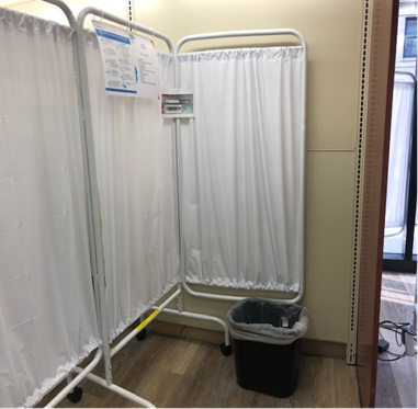 A testing bay, where individuals stand to complete a self-swab test without medical staff supervision.
