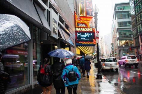 People walk on Washington Street near Paramount Theater.