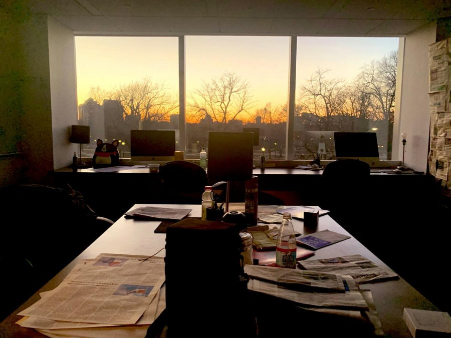 The sun sets over Boston Common as viewed from the newsroom of The Berkeley Beacon in the campus center at 172 Tremont St. on March 12, 2021.