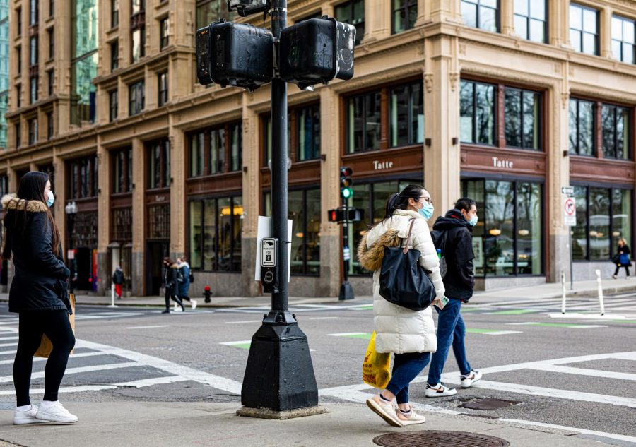 People walking through the intersection of Boylston and Tremont street.