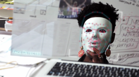 "Algorithm bias researcher Joy Buolamwini showing the racist faults in the ""Aspire Mirror."""