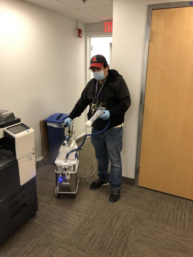 A sanitation worker cleaning a room.