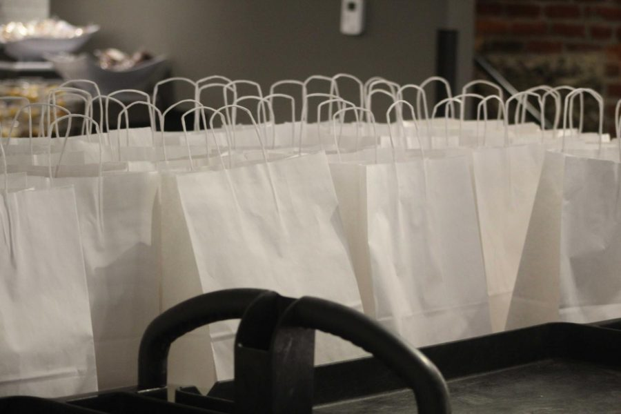 Bags of food in the Dining Center waiting to be delivered to quarantined and isolated students in Paramount.