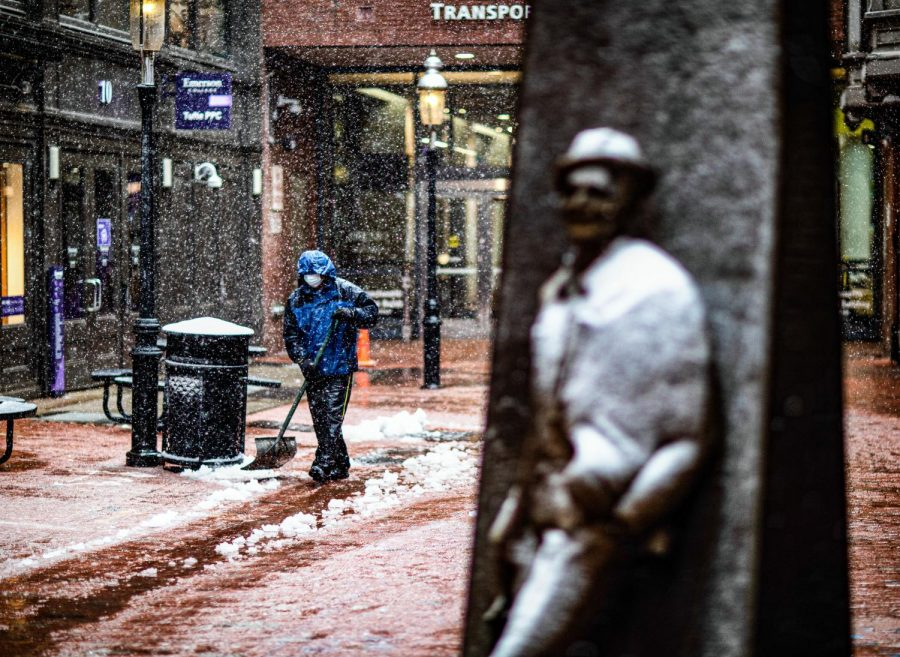 Snow dusts the Norman Lear statue in the 2 Boylston Alley