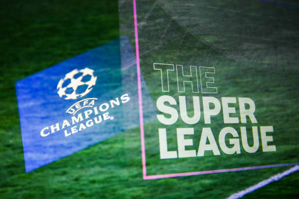 UEFA Champions League logo displayed on a phone screen and The Super League logo displayed on a screen are seen in this multiple exposure illustration photo taken in Krakow, Poland on April 20, 2021. (Photo Illustration by Jakub Porzycki/NurPhoto via Getty Images)