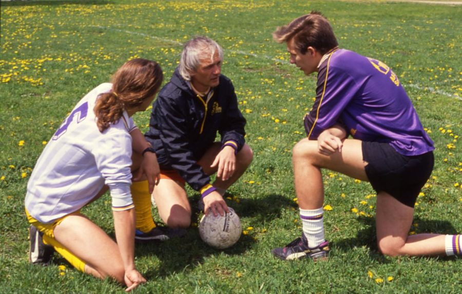Pete Chvany (center), a former Emerson professor and longtime mens soccer coach