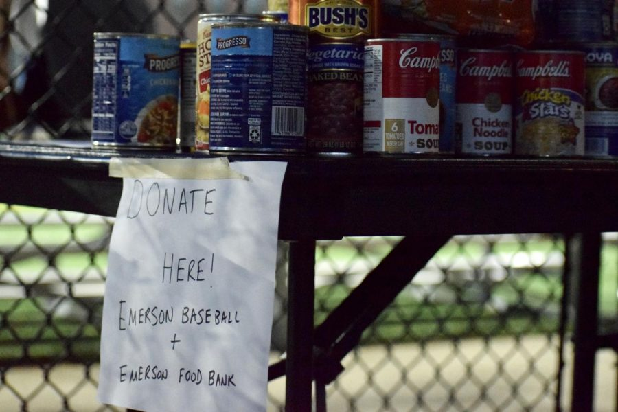 Donate station ran by the Emerson baseball team and Emerson Food Bank.