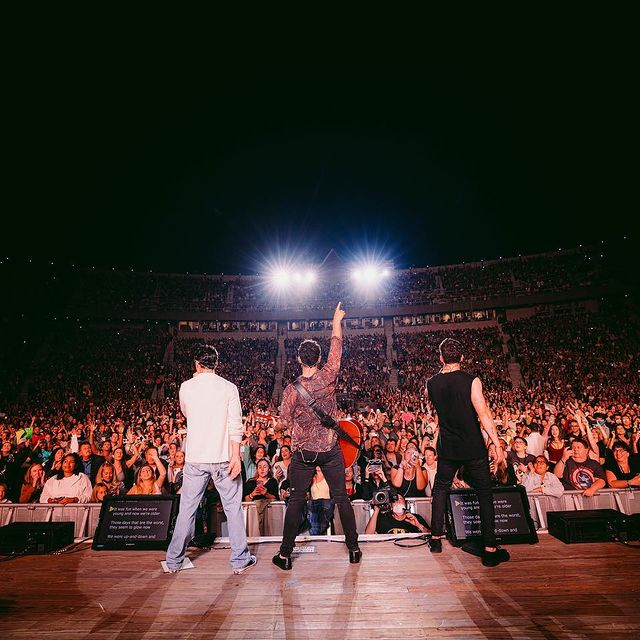 The Jonas Brothers performing at Fenway Park.