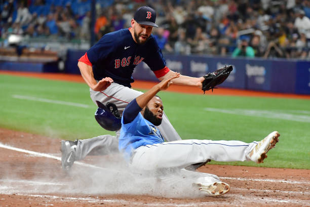 Manuel Margot #13 of the Tampa Bay Rays slides home in the ninth inning after Matt Barnes #32 of the Boston Red Sox threw a wild pitch at Tropicana Field on June 24, 2021 in St Petersburg, Florida. The  Rays defeated the Red Sox 1-0.