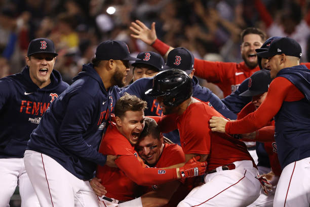 Enrique Hernandez #5 of the Boston Red Sox celebrates with teammates after they defeated the Tampa Bay Rays 6 to 5 during Game 4 of the American League Division Series at Fenway Park